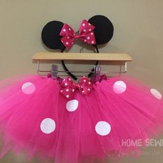 This pink Minnie Mouse tutu was made for first birthday Minnie Mouse themed cake smash.  Coordinating bow on the headband and the tutu.  Would look amazing in red as well!  Perfect for a disney themed party or even Halloween!