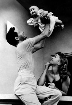 Eddie Fisher & Debbie Reynolds with their baby girl, Carrie Frances, 1957