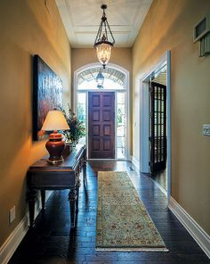 Keep decorative rugs or cotton mats in high traffic areas like the entry way to avoid tracking dirt and debris across your hardwood floors. This will keep the scuffing and scratching to a minimum.