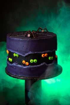 A spine-chilling showstopper of a cake made up of a slime-green sponge, petrifying purple buttercream and decorated with M&M spiders and Skittles eyes! Black Food Coloring, Gel Food Coloring, Halloween Cakes, Halloween Party, Halloween Tricks, Halloween Desserts, Halloween Movies, Halloween Stuff, Spooky Halloween