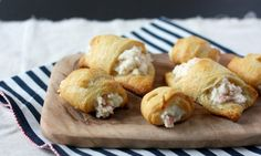 1-8 oz. tube crescent roll dough  3 oz. cream cheese, softened  1/4 cup mayonnaise  3/4 cup cooked crab meat, chopped  2 green onions, chopped  1/8- 1/4 teaspoon cayenne pepper  salt and pepper, to taste    Heat oven to 375°F. Spray cookie sheet with