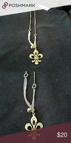 Betsey Johnson Fleur-de-lis pendant necklace Chain and pendant brushed gold with silver accents on bottom of chain Betsey Johnson Jewelry Necklaces