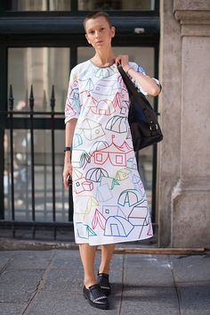 Alexandra Sevafimovieh poses wearing a RCR Khomenko dress after the Anne Sofie Madsen show during Paris Fashion Week Womenswear SS17 on September 28...