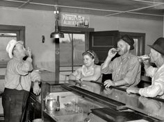 """August 1937. """"A drink on the house. Lumberjacks, proprietor and lady attendant in saloon. Craigville, Minnesota."""" Where everyone knows your name. Photo by Russell Lee for the Resettlement Administration."""