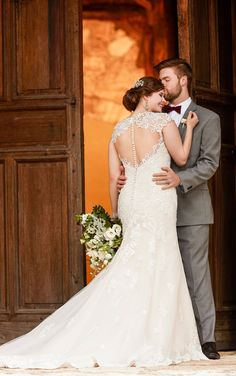 An updated silhouette for the traditional bride, this lace wedding dress with illusion back from Essense of Australia is simply dreamy!