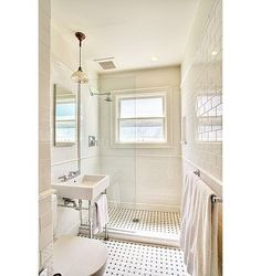 Glass shower partition (so bathroom won't look too cramped)