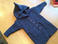 Update to the blog: Debbie Bliss, Baby Cashmerino, cable jacket with hood for baby Roy.