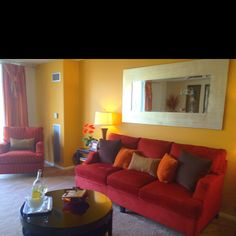 Apartment Living Room with warm colors: golden yellow, orange, brown, and a deep red :)