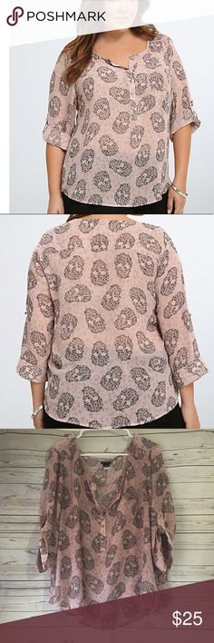 """Torrid Skull Animal Print Chiffon Popover Blouse Perfect used condition with no stains or holes. Smoke free/pet friendly home. 91% rayon/3% spandex.   Black leopard spots form skull graphics while a faded pink leopard print stamps the dusty pink semi sheer chiffon. Just when it's getting too wild smocked shoulders and a button lend polish.   Approximate Flat Measurements  Shoulder to hem: 24"""" Armpit to armpit: 23"""" torrid Tops Blouses"""