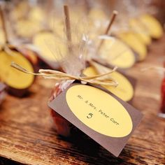 2014  candy apples wedding table card, brown and yellow table cards.