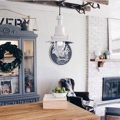 Modern farmhouse, china cabinet, antique ladder, IKEA hack pendant lights, white pendant lights, kitchen island, whitewashed brick fireplace