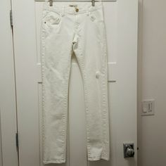 CAbi White Distressed Jeans Style 331 CAbi White Distressed Jeans Style #331. Size 0 with a  32 inch inseam.  No flaws. Note that this has distressed spots on purpose,  they are not flaws. CAbi Jeans