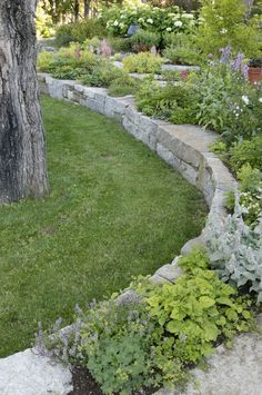 Incredible Stone Wall decorating ideas for Appealing Landscape Traditional design ideas with curved rock wall Flower beds garden garden wall granite blocks grass herb
