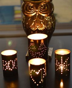 DIY tin can lantern tutorials. Make these glowing little cuties in just a few simple steps.View Post: DIY Tin Can Lanterns Aluminum Can Crafts, Tin Can Crafts, Aluminum Cans, Halloween Lanterns, Halloween Decorations, Halloween Party, Halloween Ideas, Tea Light Candles, Tea Lights