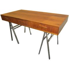 Mid-Century Modern Milo Baughman Chrome Saw Horse Walnut Desk | From a unique collection of antique and modern desks and writing tables at https://www.1stdibs.com/furniture/tables/desks-writing-tables/