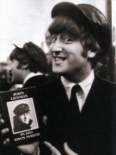 Image result for john lennon holding book