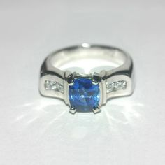 Platinum ring studded with a 1.8ct blue sapphire and .38ct diamonds.