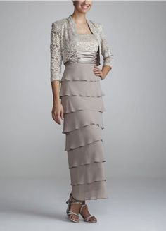 What a flawless way to put a modern spin on a mother of the bride dress!!   This elegant dazzler is unforgettable.  The epitome of figure flattering, thissmashing ensembleelongates the body.  Chiffon two- piece dress features banded waist and tieriing on the skirt.  Fully Lined. Back zip. Hand Wash Cold.  Please Note: Sale pricing varies according to color, please click color and size to view pricing.Also available in plus sizes as Style 1168W.
