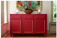 Sideboard made from old cabinets.  Great idea, looks fantastic.  Great pop of colour.