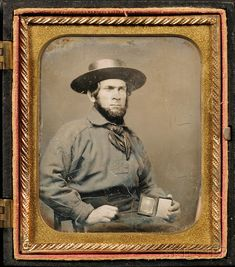 """Sixth Plate Daguerreotype of a Sailor Holding a Daguerreotype of His Wife, in a dark brown """"The Clipper Ship and the Fort"""" (Krainik 100) Union case, (light scratches, tarnish ring).  Estimate $800-1,200  Sold for $2,726"""