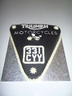 Triumph Motorcycles Logo Cake Made for my lovely dad who still misses his Triumph after all these years. Chocolate fudge cake with fondant.