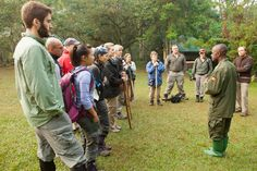 Tourists being briefed by a guide before setting off to Bwindi Impenetrable Rainforest, Uganda for gorilla trekking #travel #tourism #wildlife #rainforest #nature www.bucketlistbums.com / http://bit.ly/1u2rBhT Pearl of Uganda is AMAIDI's prefered travel partner in Uganda