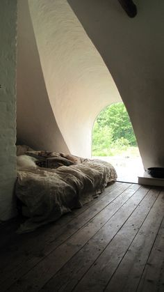 The Thatched Cottage, Denmark. This ecological house provides a comfortable living place for four persons. Upstairs there are two bedrooms, each with double beds http://www.organicholidays.com/at/3419.htm