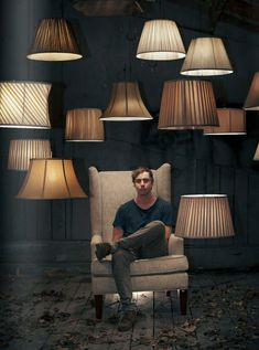 man among the lamps in the dark
