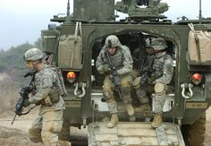 U.S. Army soldiers from Alpha Company, 1st Battalion, 27th Infantry Regiment, 2nd Stryker Brigade Combat Team exit their M1126 Stryker Infantry Carrier Vehicle during dismounted maneuvers at Warrior Valley on Rodriguez Range Complex, South Korea, on March 24, 2007, as part of exercise Foal Eagle 2007. The annual joint command post and field training exercise improves combat readiness and joint and combined interoperability.   DoD photo by Petty Officer 1st Class Daniel N. Woods, U.S. Navy