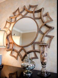 This mirror has it all in one. A litle bit of sunburst, a little bit of geometrics, a little bit of wall art: altogether with a lot of style! http://www.myswankyhome.com/geometric-sunburst-mirror/