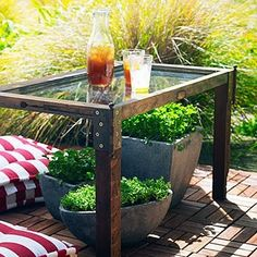 Table made from an old window, and I love the metal corner door hinges as braces!  Way to recycle!