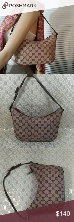 Authentic Gucci GG Monogram Brown Canvas Hobo Bag. Canvas and leather showed signs of used as the bag was preowned. The bag was made in Italy with a serial number 005 0813 001998. The dimension is 7 and 10. Overall the bag is in a good preowned condition. Gucci Bags Hobos