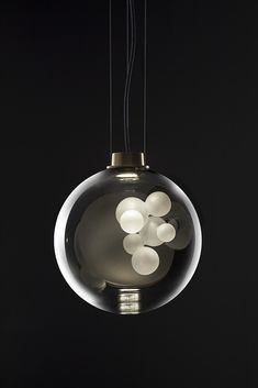 The Soap Sphere Suspension is a true marriage of technique and genius. The frosted glass sculpture within . Contemporary Light Fixtures, Modern Lighting, Lighting Design, Modern Chandelier, Design Light, Lamp Design, Solar Powered Lights, Solar Lights, Pendant Lamp