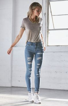 60b29aa10ef0 Online Only! The Tally Blue Ripped High Rise Skinny Jeans feature  destructed details and a medium indigo wash. These jeans boast an ultra  slim construction ...