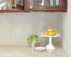 Kitchen backsplash. Light green glass subway tile. Love subway tile!