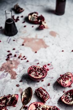A ruby red homemade pomegranate syrup, perfect to drizzle over your favourite summer breakfast or dessert treats! | Moody Food | Food Photography | Food Styling | Food Props | Anisa Sabet | The Macadames