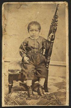 Black baby during civil war.  He looks terrified, poor little man!.