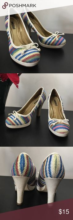 Multi-Colored Chevron High Heals Add a splash of color to any outfit with these adorable shoes! They are gently used and do show some light scuffs due to normal wear - see photos. Whether you are dressing up denim or wearing these with a dress they are sure to brighten your day! Unlisted Shoes Heels