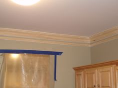 Super Thick Crown Molding Trick. Installed a basic crown molding.  Then, about 3 inches below the crown install decorative picture frame molding. After caulking the seams and painting the trim and the space in between the two pieces, it appears to be one large, thick piece.