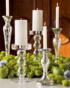 Mercury Glass candle holders, reindeer moss and granny smith bright green apples. Great centerpiece!