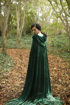Acarith has a sage green cloak in the darker seasons of the year, to blend into the forest.