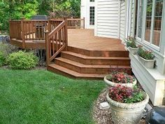 Like this deck design, now just add a stone patio with a fire pit and it would be perfect!