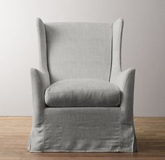 RH baby&child's Wingback Swivel Glider with Slipcover:Inspired by the timeless design of the classic wingback chair, our glider features a high back, shaped arms and slim wings – the latter originally designed to shelter occupants from drafts.