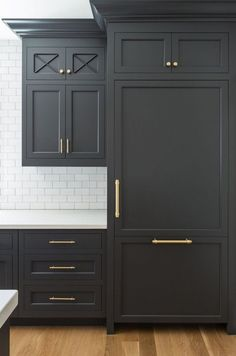 Black cabinets with gold pulls