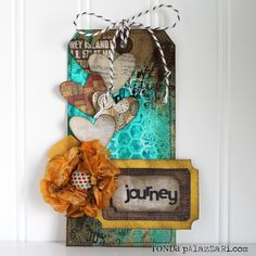 Design team member @Ronda Palazzari shared a tutorial on our blog (http://sizzixblog.blogspot.com/2012/09/journey-tag.html) for this amazing and colorful mixed media tag.
