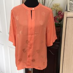 """💐KARL LAGERFELD  couture 100% silk blouse Like new, Karl Lagerfeld (designs for Chanel and Fendi) 100% coral colored couture silk blouse. Styled in an Oriental fashion, silk on silk with embossed pattern. Pls see photos. Excellent condition, Size 8 US. Top to bottom 27"""", collar to cuff 18"""", chest 20"""", shoulder to shoulder 18"""", No trade, no pp, smoke and pet free environment. Karl Lagerfeld Tops Blouses"""