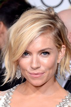 pretty wavy bob  http://www.refinery29.com/2015/01/80585/best-golden-globes-red-carpet-hair-makeup-2015#slide-11  Sienna Miller  Miller's chic, fairly new bob was crafted to wavy perfection. Hair guru Jenny Cho created loose waves using a medium-sized curling iron on small sections, and then sprayed a healthy amount of Suave Dry Shampoo all over, shaking it out for easy movement.