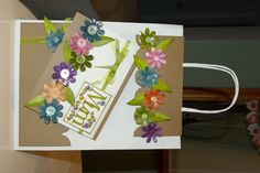 Decorated paper gift bag with greeting card