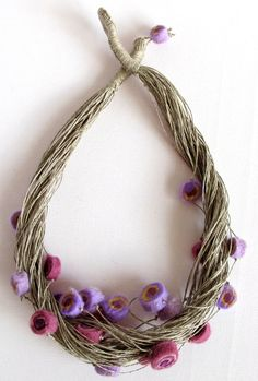 Lavender, violet and yellow felt beads threaded on a linen string. Original handmade felt necklace made of merino wool. This necklace is soft and light.