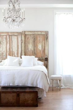 Love this!   chandelier and distressed timber